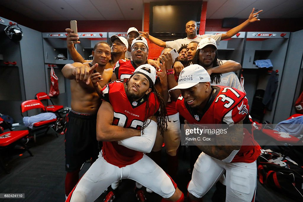 Jalen Collins #32 and Ricardo Allen #37 of the Atlanta Falcons celebrate with teammates in the locker room after defeating the Green Bay Packers in the NFC Championship Game at the Georgia Dome on January 22, 2017 in Atlanta, Georgia. The Falcons defeated the Packers 44-21.