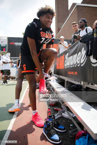 Jalen Green laces up his shoes prior to the SLAM Summer Classic 2019 at Dyckman Park on August 18 2019 in New York City