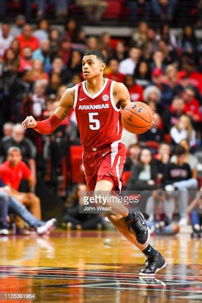 Jalen Harris of the Arkansas Razorbacks brings the ball up court during the game against the Texas Tech Red Raiders on January 26 2019 at United...