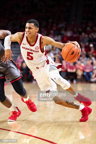 Jalen Harris of the Arkansas Razorbacks drives to the basket during a game against the Austin Peay Governors at Bud Walton Arena on December 28 2018...