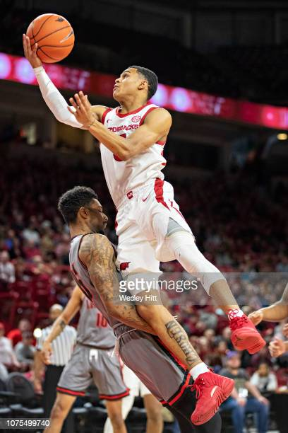 Jalen Harris of the Arkansas Razorbacks goes up for a shot over Jabari McGhee of the Austin Peay Governors at Bud Walton Arena on December 28 2018 in...