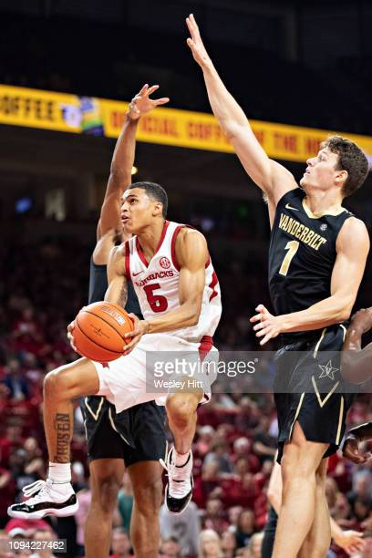 Jalen Harris of the Arkansas Razorbacks goes up for s shot past Yanni Wetzell of the Vanderbilt Commodores at Bud Walton Arena on February 5 2019 in...