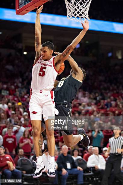 Jalen Harris of the Arkansas Razorbacks goes up to block the shot of Saben Lee of the Vanderbilt Commodores at Bud Walton Arena on February 5 2019 in...