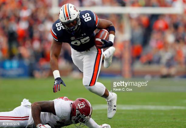 Jalen Harris of the Auburn Tigers is tackled by Anfernee Jennings of the Alabama Crimson Tide after catching a pass during the first quarter of their...