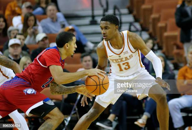 Jalen Harris of the Louisiana Tech Bulldogs drives against Jase Febres of the Texas Longhorns at the Frank Erwin Center on December 16 2017 in Austin...