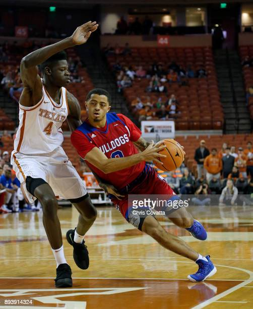Jalen Harris of the Louisiana Tech Bulldogs drives around Mohamed Bamba of the Texas Longhorns sat the Frank Erwin Center on December 16 2017 in...