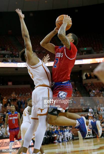 Jalen Harris of the Louisiana Tech Bulldogs leaps to the basket over Jacob Young of the Texas Longhorns at the Frank Erwin Center on December 16 2017...