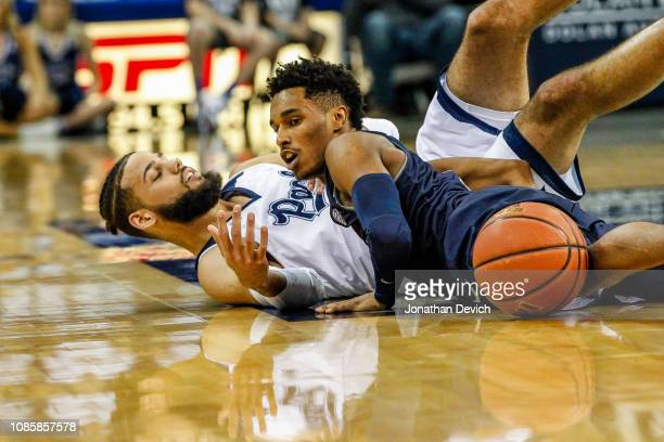Jalen Harris of the Nevada Wolf Pack lands on Cody Martin of the Nevada Wolf Pack while going after the ball during the second half at Lawlor Events...