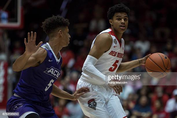 Jalen Harris of the New Mexico Lobos dribbles the ball as he's guarded by Payten Ricks of the Abilene Christian Wildcats at The Pit on November 30...