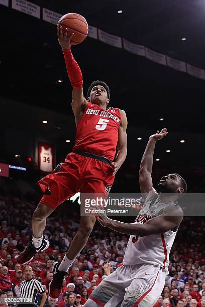 Jalen Harris of the New Mexico Lobos lays up a shot past Kadeem Allen of the Arizona Wildcats during the second half of the college basketball game...