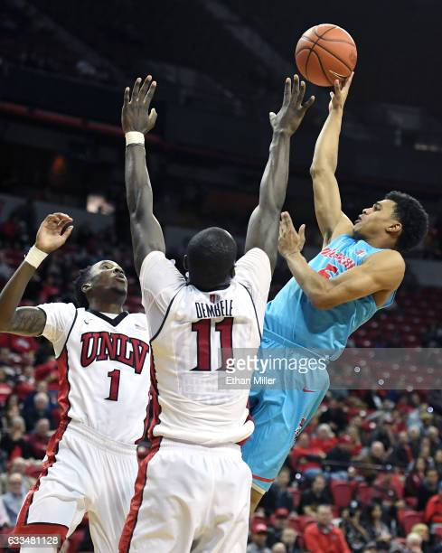 Jalen Harris of the New Mexico Lobos shoots against Kris Clyburn and Cheickna Dembele of the UNLV Rebels during their game at the Thomas Mack Center...