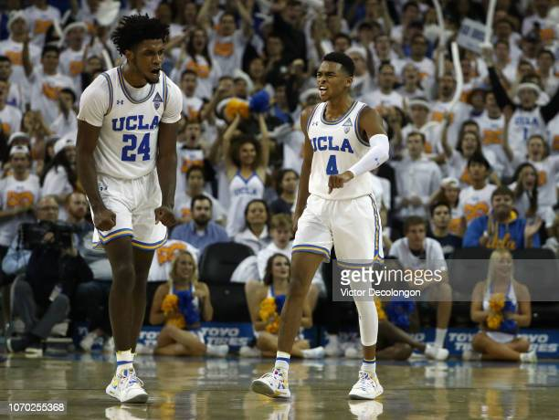 Jalen Hill and Jaylen Hands of the UCLA Bruins celebrate after a defensive play by Hill which resulted in UCLA getting ball possession during the...