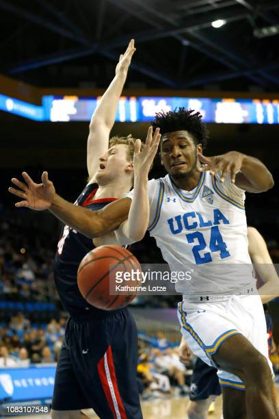 Jalen Hill of the UCLA Bruins and Caleb Hollander of the Belmont Bruins go after a rebound during the second half at Pauley Pavilion on December 15...