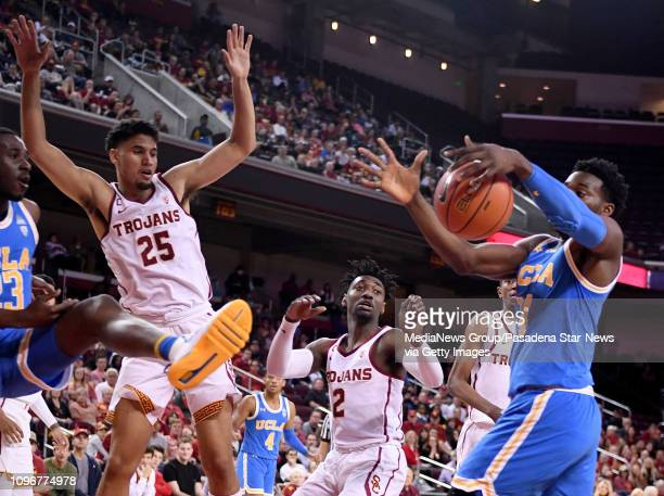 Jalen Hill of the UCLA Bruins scrambles for the loose ball against the USC Trojans in the first half of a NCAA basketball game at the Galen Center on...