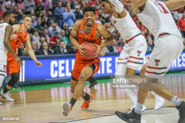Jalen Hudson of the Florida Gators drives to the basket during the NCAA Div I Men's Championship Second Round basketball game between Florida and...