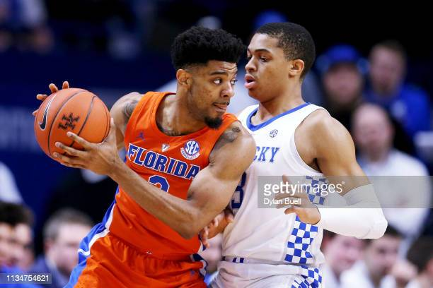 Jalen Hudson of the Florida Gators handles the ball while being guarded by Keldon Johnson of the Kentucky Wildcats in the first half at Rupp Arena on...