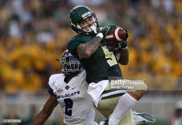 Jalen Hurd of the Baylor Bears makes a touchdown pass reception against Brandon Richmond of the Abilene Christian Wildcats at McLane Stadium on...