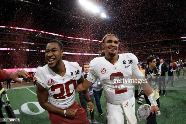 Jalen Hurts and Shaun Dion Hamilton of the Alabama Crimson Tide celebrate beating the Georgia Bulldogs in overtime to win the CFP National...
