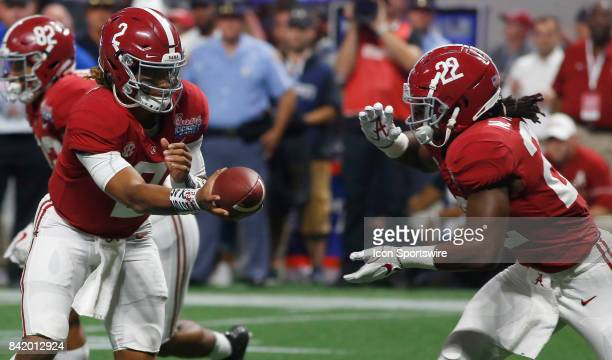 Jalen Hurts hands off to Najee Harris during the college football game between the Alabama Crimson Tide and the Florida State University Seminoles on...