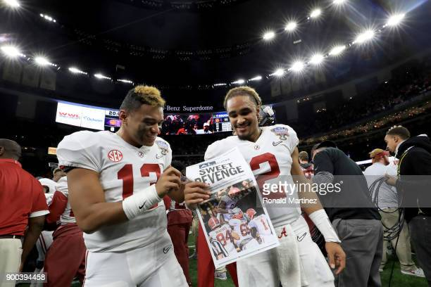 Jalen Hurts of the Alabama Crimson Tide and Tua Tagovailoa celebrate after winning the AllState Sugar Bowl against the Clemson Tigers at the...