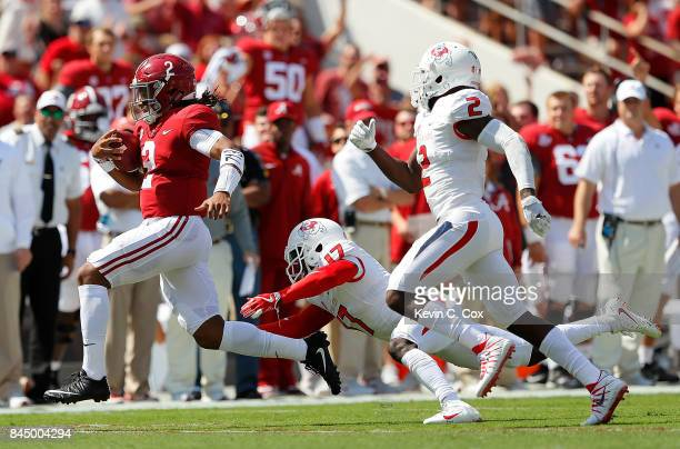 Jalen Hurts of the Alabama Crimson Tide breaks a tackle by John Johnson of the Fresno State Bulldogs on the way to a touchdown at BryantDenny Stadium...