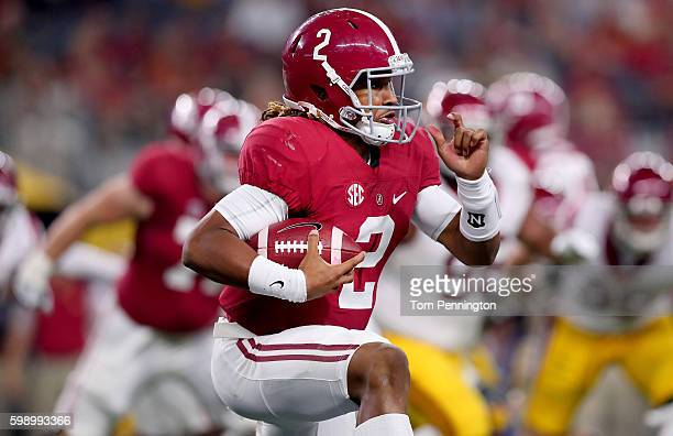 Jalen Hurts of the Alabama Crimson Tide carries the ball against the USC Trojans in the third quarter during the AdvoCare Classic at ATT Stadium on...