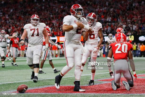 Jalen Hurts of the Alabama Crimson Tide celebrates after rushing for a 15yard touchdown in the fourth quarter against the Georgia Bulldogs during the...