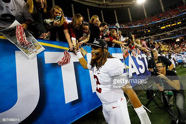 Jalen Hurts of the Alabama Crimson Tide celebrates their 54 to 16 win over the Florida Gators in the SEC Championship game at the Georgia Dome on...