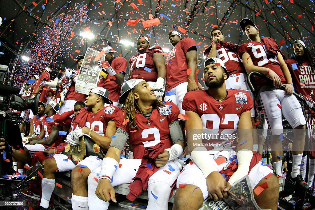 Jalen Hurts #2 of the Alabama Crimson Tide celebrates with his teammates after winning 24 to 7 against Washington Huskies during the 2016 Chick-fil-A Peach Bowl at the Georgia Dome on December 31, 2016 in Atlanta, Georgia.