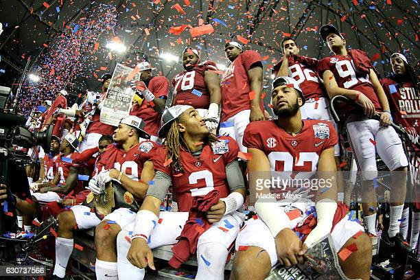 Jalen Hurts of the Alabama Crimson Tide celebrates with his teammates after winning 24 to 7 against Washington Huskies during the 2016 ChickfilA...
