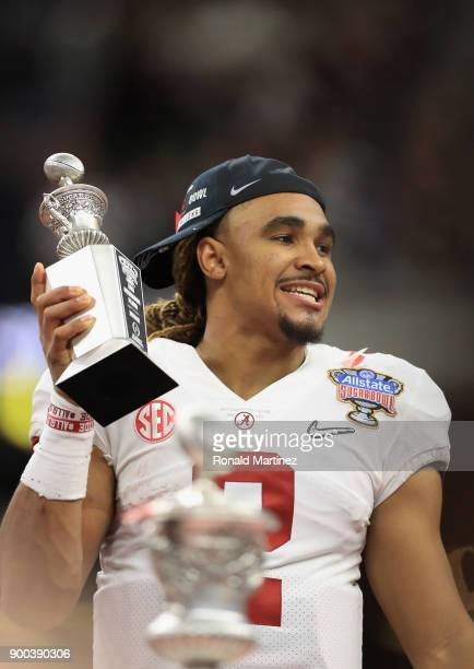 Jalen Hurts of the Alabama Crimson Tide celebrates with the offensive player of the game trophy after the AllState Sugar Bowl against the Clemson...
