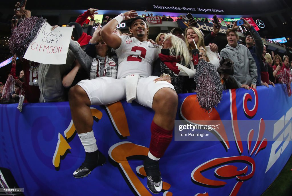 Jalen Hurts #2 of the Alabama Crimson Tide celebrtes with fans after the AllState Sugar Bowl against the Clemson Tigers at the Mercedes-Benz Superdome on January 1, 2018 in New Orleans, Louisiana.