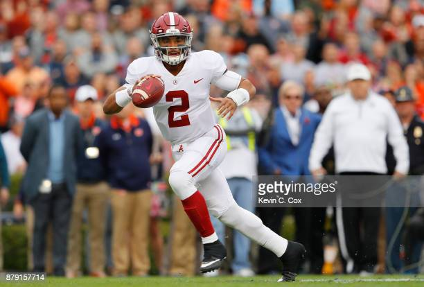 Jalen Hurts of the Alabama Crimson Tide drops back to pass during the first quarter against the Auburn Tigers at Jordan Hare Stadium on November 25...