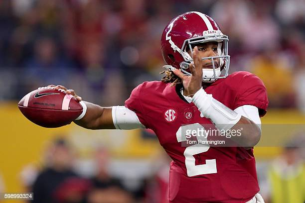 Jalen Hurts of the Alabama Crimson Tide looks for an open receiver against the USC Trojans in the third quarter during the AdvoCare Classic at ATT...