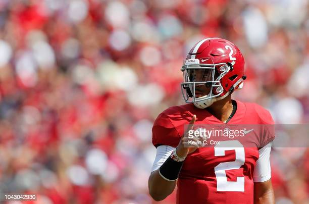 Jalen Hurts of the Alabama Crimson Tide looks to the sidelines for the play call against the Louisiana Ragin Cajuns at BryantDenny Stadium on...