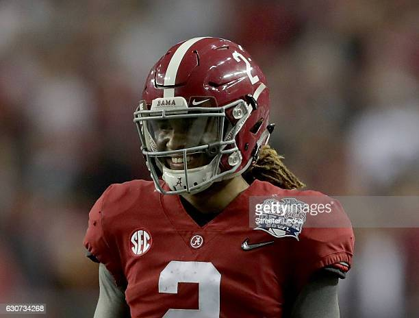 Jalen Hurts of the Alabama Crimson Tide reacts after a touchdown against the Washington Huskies during the 2016 ChickfilA Peach Bowl at the Georgia...