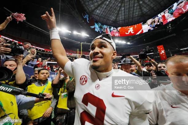 Jalen Hurts of the Alabama Crimson Tide reacts after defeating the Georgia Bulldogs 3528 in the 2018 SEC Championship Game at MercedesBenz Stadium on...