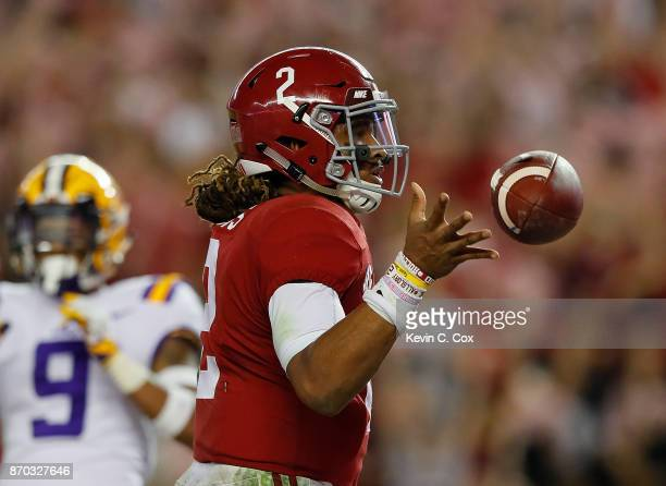 Jalen Hurts of the Alabama Crimson Tide reacts after rushing for a touchdown against the LSU Tigers at BryantDenny Stadium on November 4 2017 in...