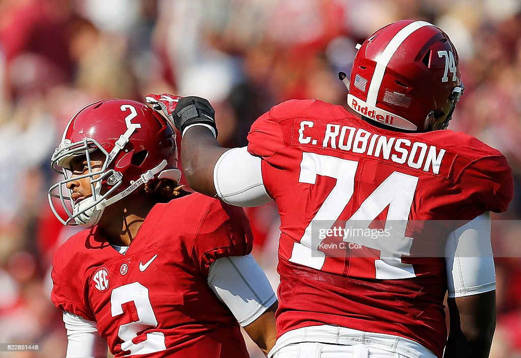 Jalen Hurts #2 of the Alabama Crimson Tide reacts with Cam Robinson #74 after passing for a touchdown against the Mississippi State Bulldogs at Bryant-Denny Stadium on November 12, 2016 in Tuscaloosa, Alabama.