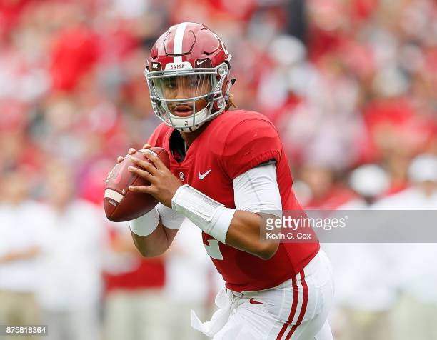Jalen Hurts of the Alabama Crimson Tide rolls out to pass against the Mercer Bears at BryantDenny Stadium on November 18 2017 in Tuscaloosa Alabama
