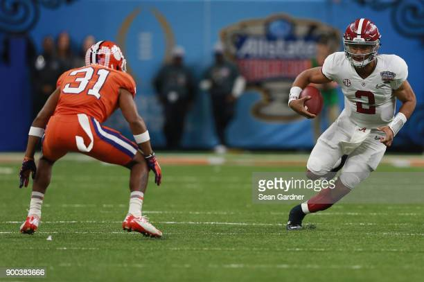Jalen Hurts of the Alabama Crimson Tide run with the ball as Ryan Carter of the Clemson Tigers defends in the second half of the AllState Sugar Bowl...
