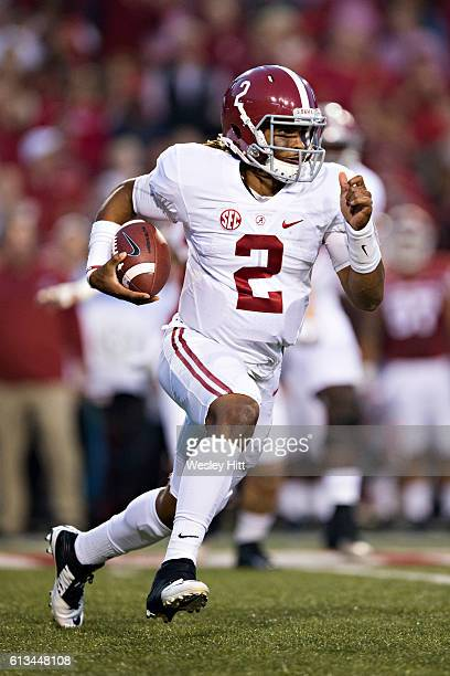 Jalen Hurts of the Alabama Crimson Tide runs the ball during a game against the Arkansas Razorbacks at Razorback Stadium on October 8 2016 in...