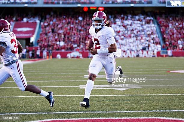 Jalen Hurts of the Alabama Crimson Tide runs the ball in for a touchdown in the first half of a game against the Arkansas Razorbacks at Razorback...