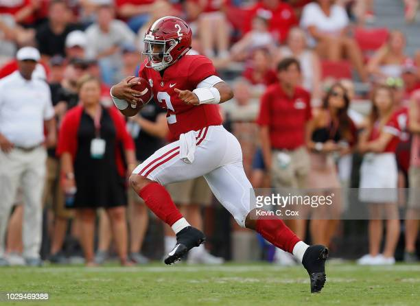 Jalen Hurts of the Alabama Crimson Tide rushes against the Arkansas State Red Wolves at BryantDenny Stadium on September 8 2018 in Tuscaloosa Alabama