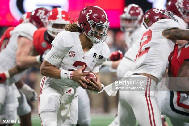 Jalen Hurts of the Alabama Crimson Tide rushes against the Georgia Bulldogs during the College Football Playoff National Championship held at...