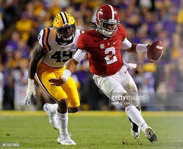 Jalen Hurts of the Alabama Crimson Tide rushes away from Arden Key of the LSU Tigers at Tiger Stadium on November 5 2016 in Baton Rouge Louisiana