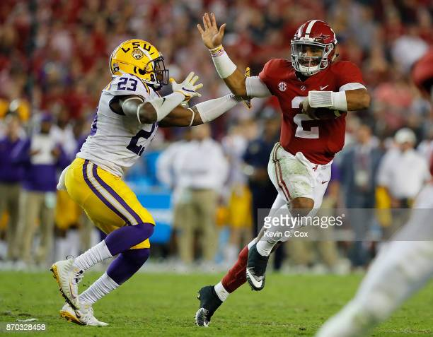 Jalen Hurts of the Alabama Crimson Tide rushes away from Corey Thompson of the LSU Tigers at BryantDenny Stadium on November 4 2017 in Tuscaloosa...