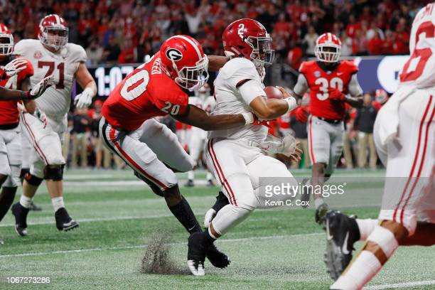 Jalen Hurts of the Alabama Crimson Tide rushes for a 15yard touchdown in the fourth quarter against the Georgia Bulldogs during the 2018 SEC...