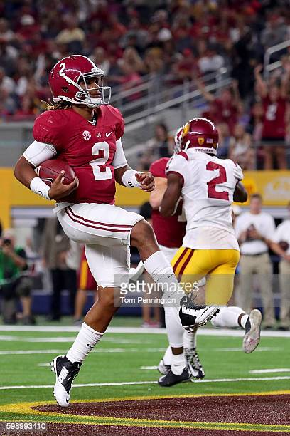 Jalen Hurts of the Alabama Crimson Tide scores a touchdown against the USC Trojans in the third quarter during the AdvoCare Classic at ATT Stadium on...