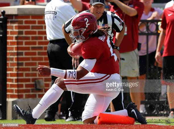 Jalen Hurts of the Alabama Crimson Tide scores a touchdown as he runs over the pylon against the Fresno State Bulldogs at BryantDenny Stadium on...